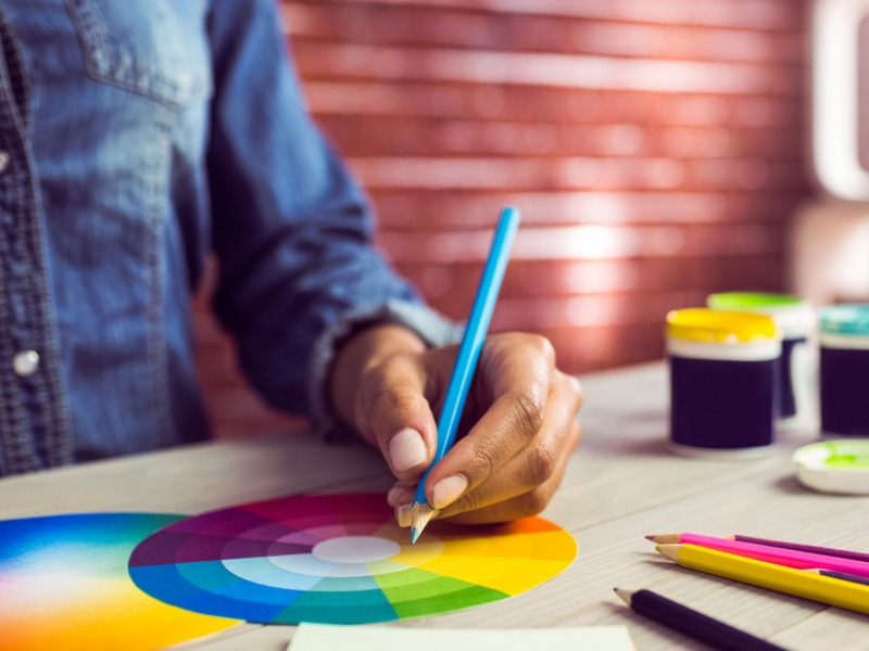 man drawing color wheel